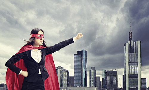 Female superhero standing in front of a city